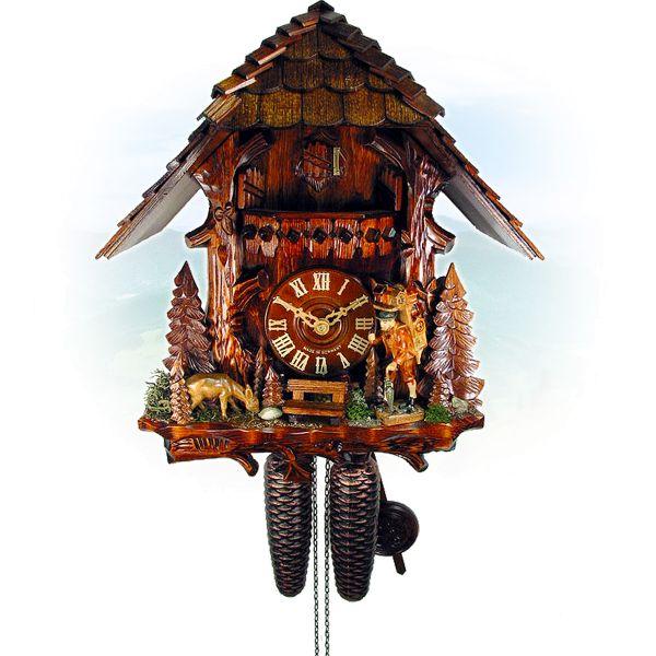 Kuckucksuhr Oviedo, August Schwer: Baumstamm, Uhrenträger